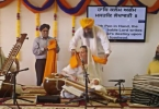 Dr. Cassio performing kirtan at Hicksville Gurdwara, NY with Parminder Singh Bhamra (pakhawaj) and Nirvair Kaur Khalsa (taus)